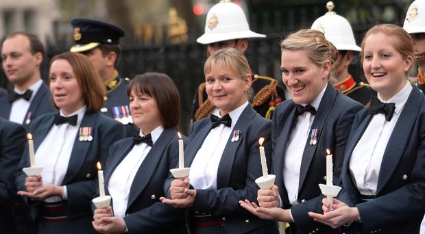 Members of the three armed services take a break from recording a single at Westminster Abbey