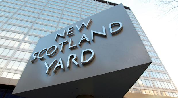 The journalists say Scotland Yard is keeping data about them on secret databases