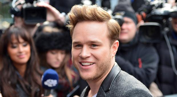 Singer Olly Murs has opened up about the feud with his twin brother
