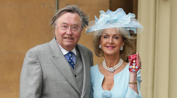 David Mellor accompanied his partner, Penelope, Viscountess Cobham, to the Investiture ceremony with the Prince of Wales