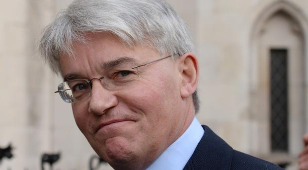 Former cabinet minister Andrew Mitchell sued News Group Newspapers