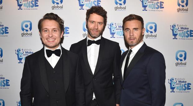 Take That (left-right) Mark Owen, Howard Donald and Gary Barlow have notched up their 12th number one single