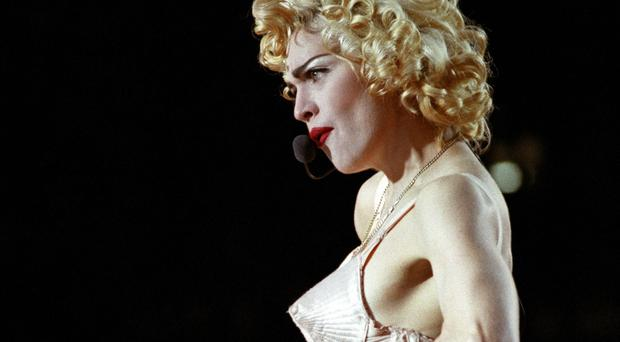 Madonna has posed topless in a US magazine