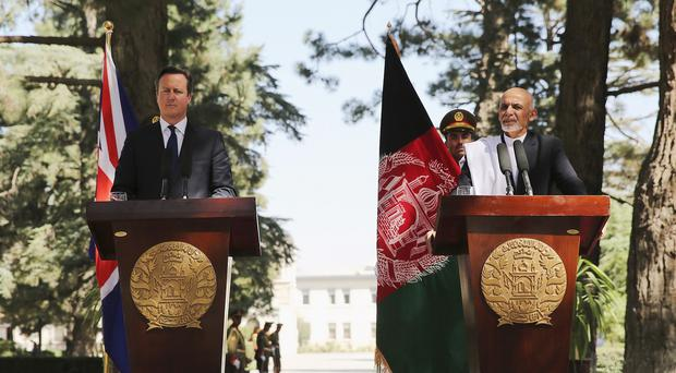Ashraf Ghani (right) is the new leader of Afghanistan
