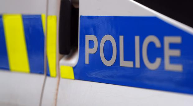 Two men have been arrested during dawn raids by counter-terrorism police
