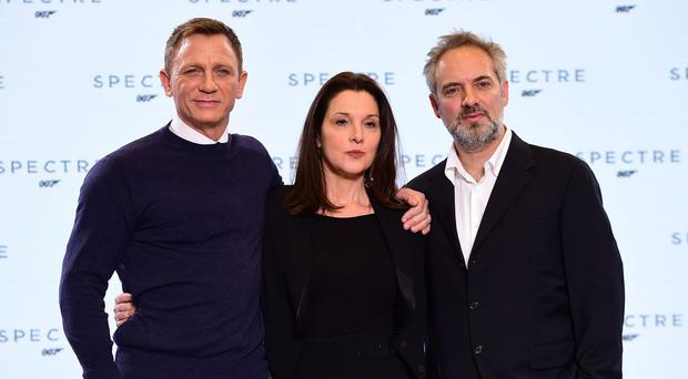 From left, Daniel Craig, Barbara Broccoli and Sam Mendes at the revealing of Spectre, the new James Bond film