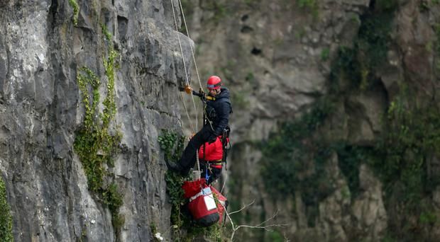 A rescuer scales down the Avon Gorge yesterday