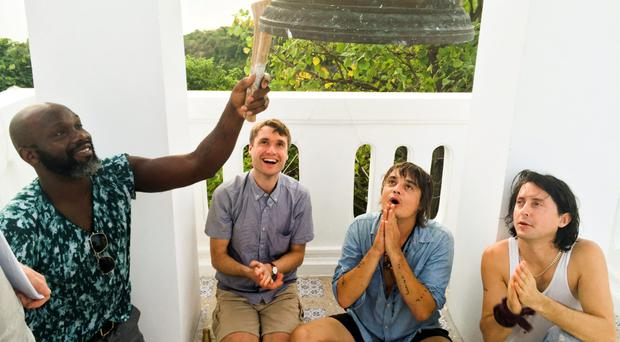 Pete Doherty (second right) was joined in Thailand by his Libertines bandmates Gary Powell, John Hassall and Carl Barat to seal the contract