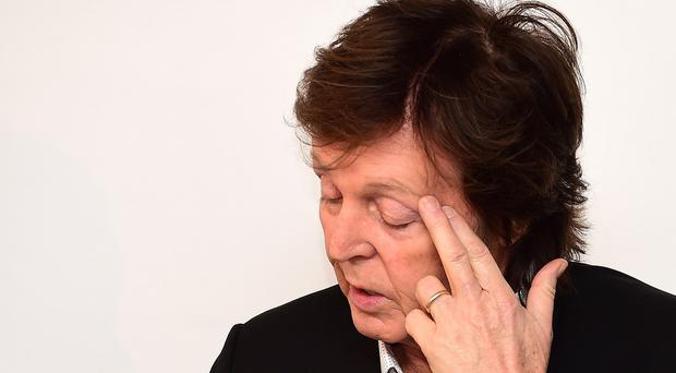 Sir Paul McCartney has told of his shock at the murder of fellow former Beatle John Lennon