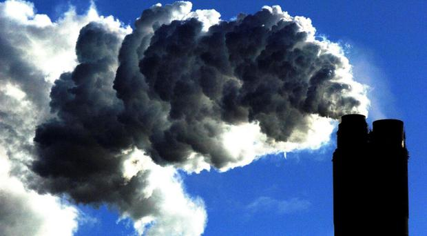 MPs have urged a ban on building projects near air pollution danger zones