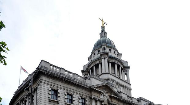 A student told the Old Bailey he posed for a photo with guns