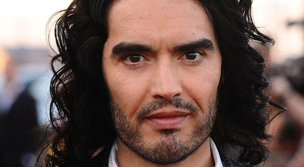 Russell Brand tweeted the mobile number of a Daily Mail journalist after the reporter went to Brand's mother's house and posted his business card through her letter box