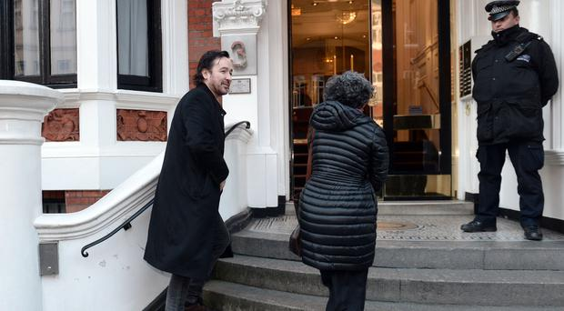 John Cusack arrives at the Equadorian Embassy to visit Julian Assange