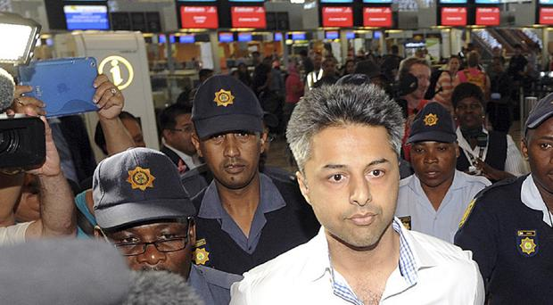 Shrien Dewani, leaving Cape Town Airport. He has now arrived in the UK