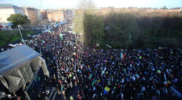 A section of the massive crowd of protesters on their way to the Dail yesterday
