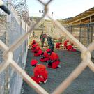 Detainees watched by US military police at Guantanamo Bay, where many were tortured