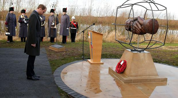 Prince William at the Football Remembers memorial yesterday to commemorate the 1914 Christmas Truce at the National Memorial Arboretum