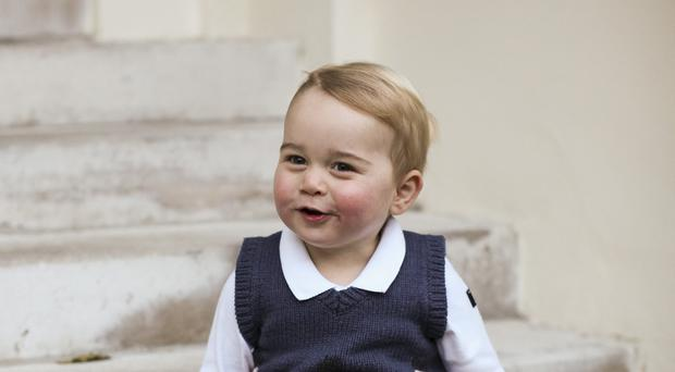 One of three new photos issued by the Duke and Duchess of Cambridge of Prince George in a courtyard at Kensington Palace (TRH The Duke and Duchess of Cambridge/PA Wire)