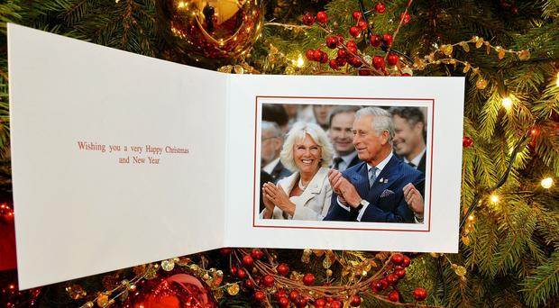 The personal Christmas card produced for the Prince of Wales and Duchess of Cornwall, which features a photograph of the couple at the Invictus Games in September
