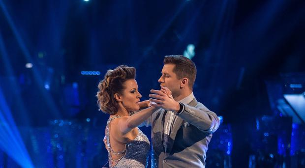 Caroline Flack is the new favourite to win Strictly Come Dancing after scoring a perfect 40 with her partner Pasha Kovalev