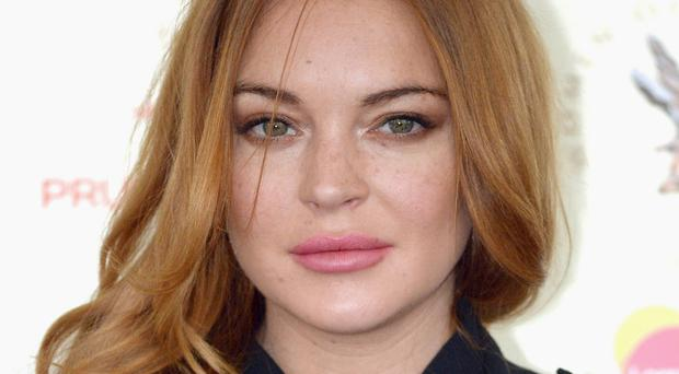 Lindsay Lohan said she plans to remain in London rather than returning to Los Angeles