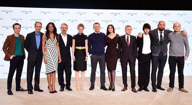 Director Sam Mendes and actor Daniel Craig stand with some of the cast at the unveiling of the new James Bond film at Pinewood Studio