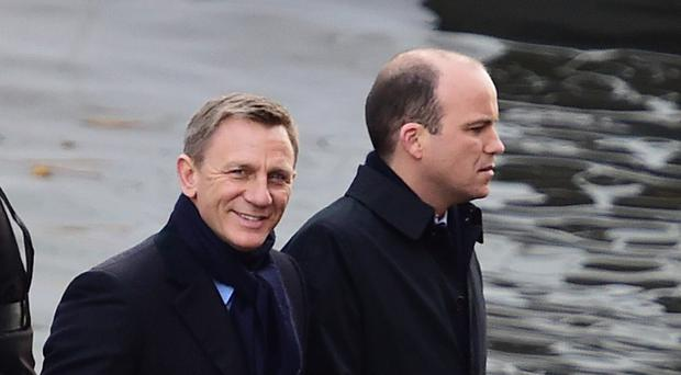Rory Kinnear and Daniel Craig, left, stand at the front of a speedboat on the Grand Union Canal in Camden, as they film scenes for the new Bond film Spectre