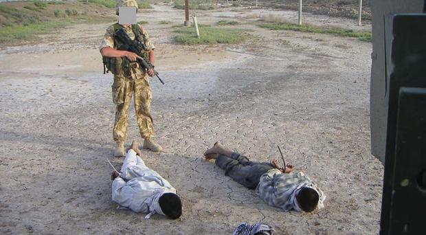 Photo of detained Iraqis being guarded by a British soldier that was shown at the the Al-Sweady Inquiry