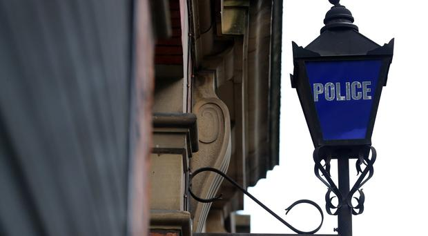 A police sergeant and two civilians have been charged over a death in custody