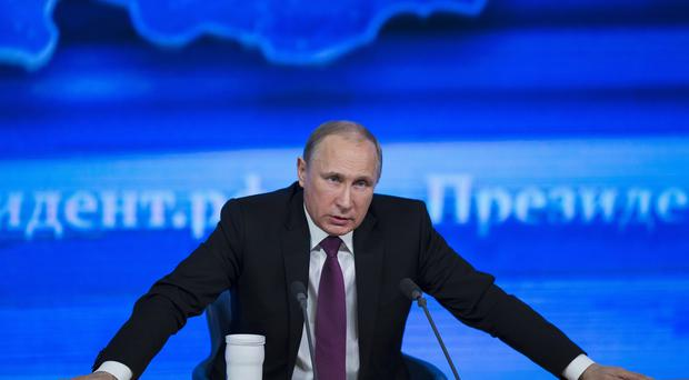 Vladimir Putin has accused the West of trying to turn Moscow into a