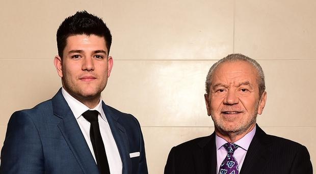 The Apprentice winner Mark Wright, 24, celebrates with Lord Sugar in London.