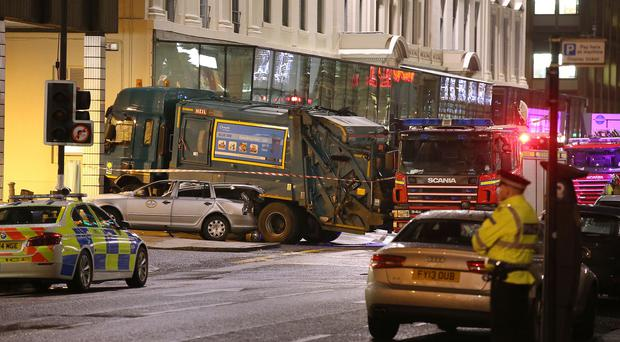 The scene in Glasgow's George Square after an out-of-control bin lorry careered through streets packed with Christmas shoppers and killed six people and seriously injured seven more.