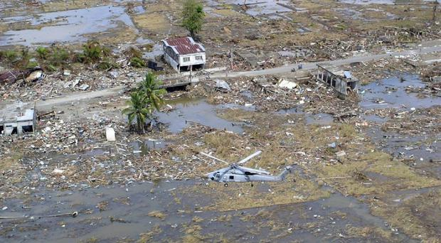 An aid worker has criticised the way money was spent in the 10 years after the tsunami hit Indonesia