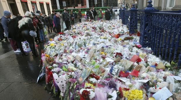 Floral tributes left to the victims in Glasgow after a bin lorry lost control and killed six people