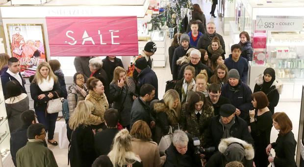 Shoppers in Harvey Nichols department store in Edinburgh, searching for a bargain during the post-Christmas sales