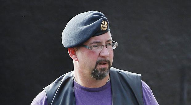 David Haines's brother Mike (pictured) has vowed to carry on his sibling's humanitarian work