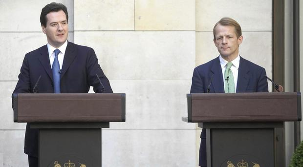 David Laws, right, is the latest senior Liberal Democrat to attack Chancellor George Osborne's spending plans