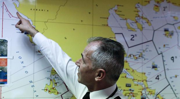 Athanasios Athanasopoulos, chief of Greece's coast guard, indicates the last known position of the stricken Norman Atlantic ferry (AP)