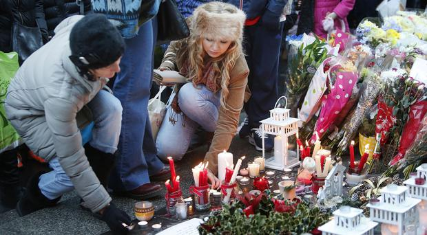 Candles are lit as hundreds of people attend a vigil near the Gallery of Modern Art in Glasgow, after the lorry crash which killed six people