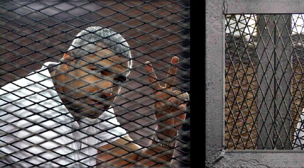 Mohamed Fahmy is one of three Al-Jazeera journalists currently being held in Egypt (AP)