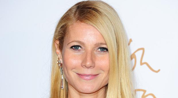 Gwyneth Paltrow has said she is proud of 'working through so much stuff' with ex-husband Chris Martin
