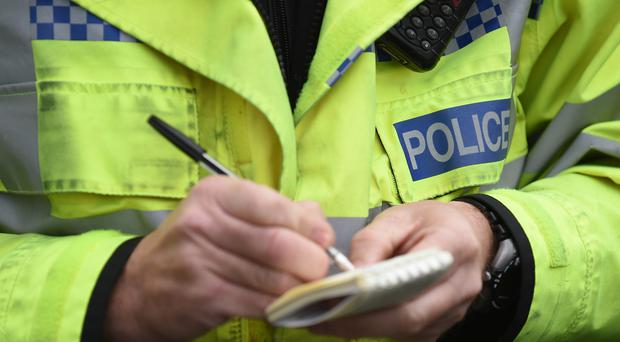 Police remain at the scene of the aircraft crash in Hampshire