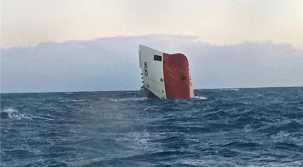 The upturned hull of the Cemfjord cargo ship off the Scottish coast