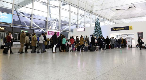 Passengers at Stansted Airport faced long security queues and delays of up to an hour on some flights because of the exit door blunder