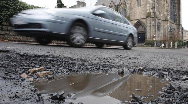 Some councils face a huge backlog of potholes