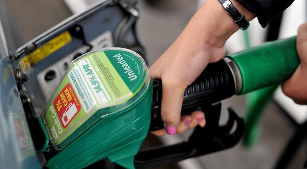 A person using an Asda petrol pump, as the supermarket cut its fuel prices again, with others likely to follow