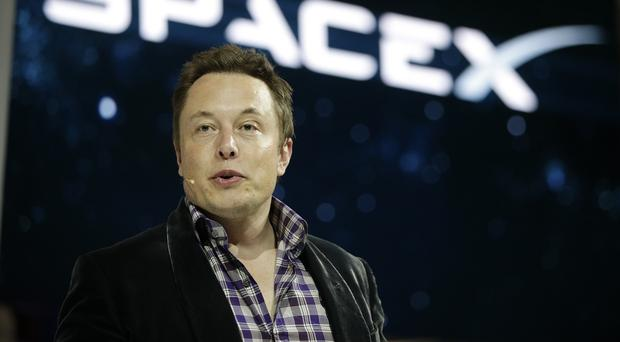Elon Musk introduces the Dragon V2 spaceship at the SpaceX headquarters in Hawthorne, California