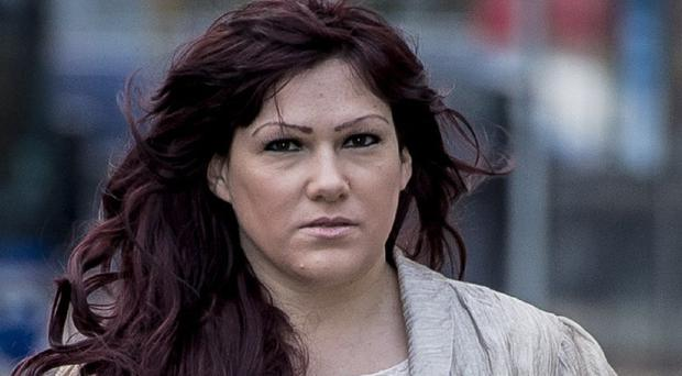 Joanne Mjadzelics, 39, the ex-girlfriend of Lostprophets singer Ian Watkins, arrives at Cardiff Crown Court where she is on trial accused of possessing and distributing indecent images of children
