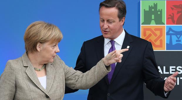 German Chancellor Angela Merkel with Prime Minister David Cameron at a Nato summit