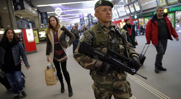 A French soldier patrols at the Montparnasse railway station in Paris, after the deadly attack (AP)